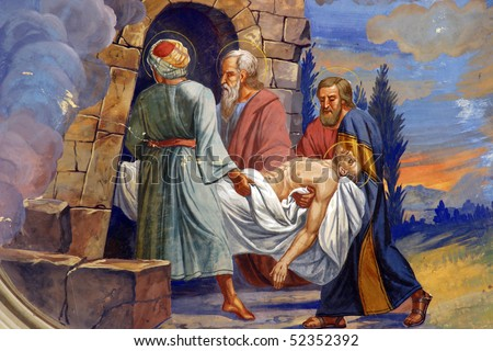 Jesus is laid in the tomb - stock photo