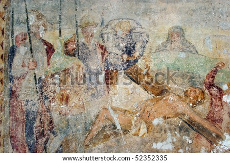Jesus is nailed to the cross, fresco paintings in the old church - stock photo