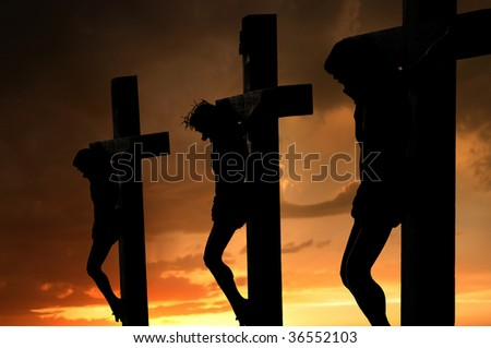jesus on cross silhouette and the clouds at sunset - stock photo