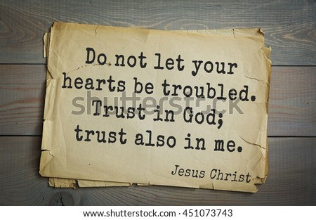 Jesus quote on old paper background. Do not let your hearts be troubled. Trust in God; trust also in me. - stock photo