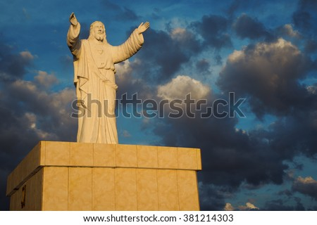 Jesus sculpture shooted a sunset in Iloilo Philippines. - stock photo