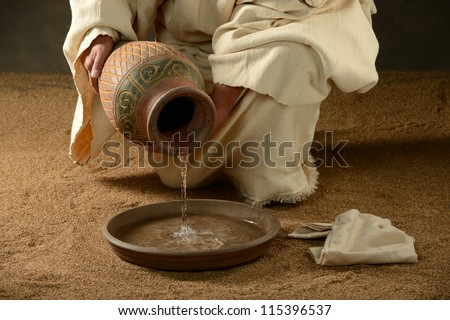 Jesus with a jug of water and a towel on a neutral background - stock photo