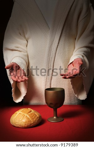 Jesus with scars in his hands at the Communion table with bread and wine - stock photo