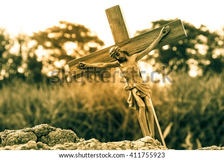 Jesus with the cross,Faith belief and hope concept,Vintage sepia - stock photo