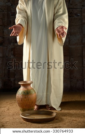 Jesus with water jar and pan inside vintage building - stock photo