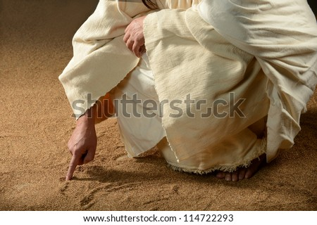 Jesus Writing on the sand with his finger - stock photo