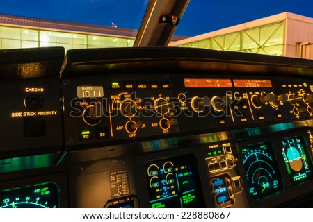 Jet aircraft cockpit buttons and knobs. - stock photo