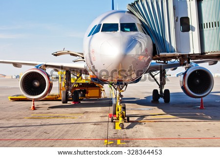 Jet aircraft docked in airport - stock photo