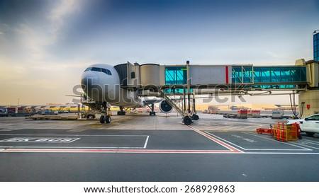 Jet aircraft docked in Dubai International Airport - stock photo