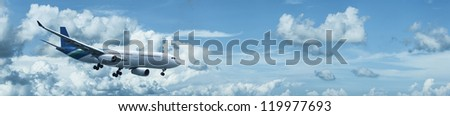 Jet aircraft in flight. Panoramic composition. - stock photo