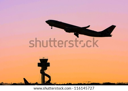 Jet airliner in flight at sunset - stock photo