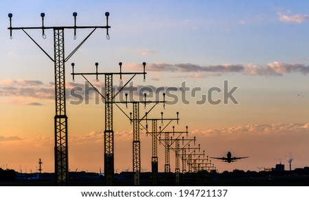 Jet Airplane Airport Runway Lights at sunset in Schipol Airport, Netherlands - stock photo