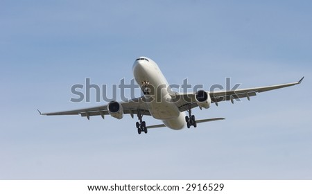 jet banking on approach to runway - stock photo
