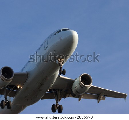 Jet coming in on final approach - stock photo