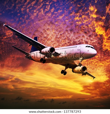 Jet in a sky at sunset time. Square composition. - stock photo