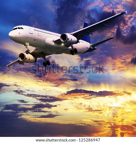 Jet in a sunset sky. Square composition. - stock photo