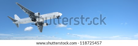Jet in flight. Panoramic composition. - stock photo