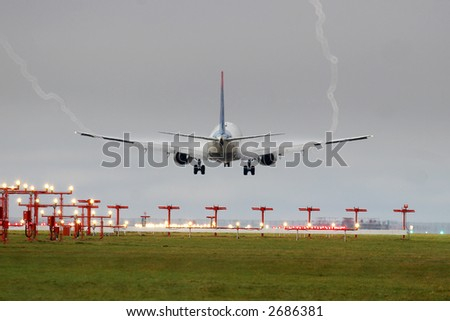 jet landing on a foggy morning with vapur vortex coming off the wings - stock photo