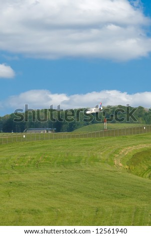Jet Landing On Airport Runway at CVG International Airport in Kentucky USA - stock photo