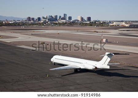 Jet on tarmac of major airport - stock photo