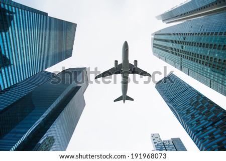 Jet over City - stock photo