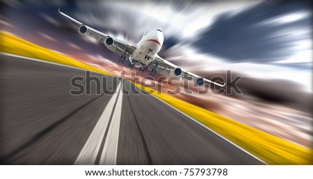 Jet plane above runway with blur background - stock photo