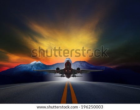 jet plane flying over runways against rock mountain and beautiful dusky sky with copy space use for air transport ,journey and traveling industry business  - stock photo