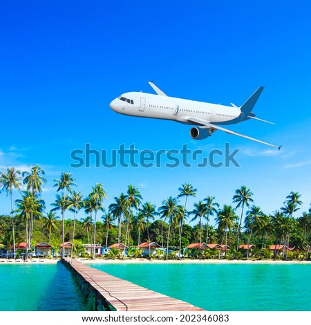 Jet plane over the tropical sea - stock photo