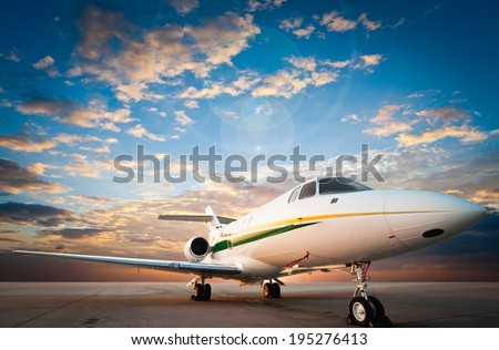 jet plane parked with nice sky - stock photo