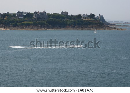 Jet ski playing off Normady coast - stock photo
