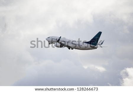 jet taking off at vancouver airport - stock photo