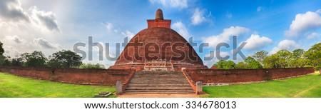 Jetavanaramaya dagoba in the ruins of Jetavana in the sacred world heritage city of Anuradhapura, Sri Lanka. Panorama - stock photo