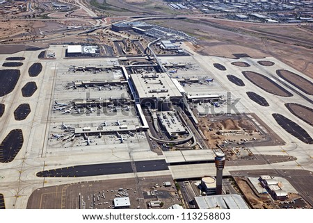 Jets at Terminal Gates of a major airport - stock photo