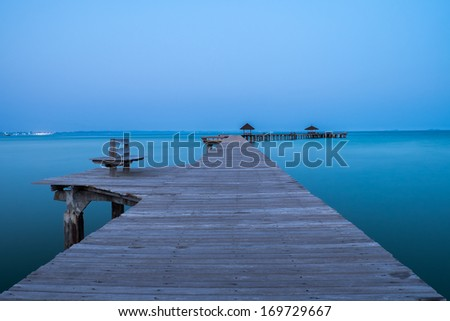Jetty at dusk - stock photo
