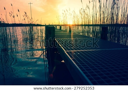 Jetty at Sunset - stock photo