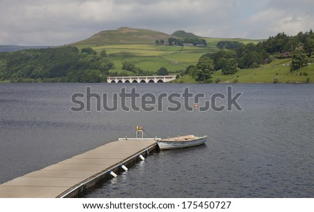 jetty in the peak district overlooking mountains on an overcast day  - stock photo