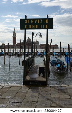 Jetty leading to the waters of Venice harbour with the San Giorgio Monastery in the background, Venice, Italy - stock photo