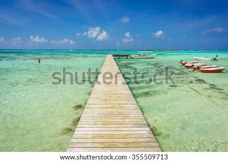 Jetty on a beach in Moorea, Tahiti - stock photo