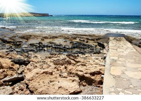Jetty on the sea beach landscape background - stock photo