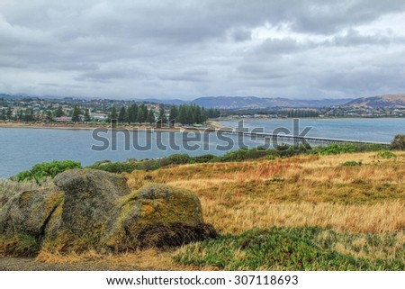 Jetty stretches out to Granite Island, tourist attraction in South Australia - stock photo