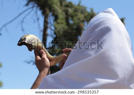 Jew blowing the shofar of Rosh Hashanah - stock photo