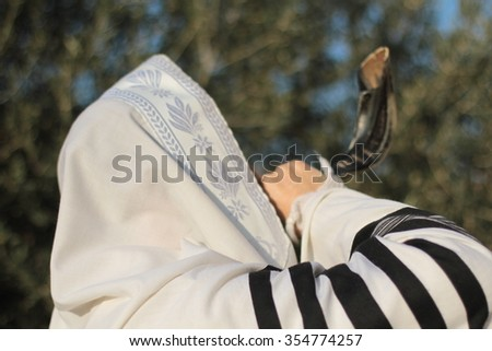 Jew blowing the shofar of Rosh Hashanah - stock photo