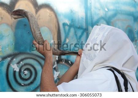 Jew blowing the shofar of Rosh Hashanah (ram's horn).  - stock photo