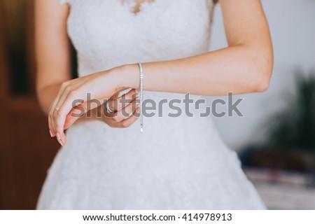 jeweler bracelet on the bride's hand - stock photo