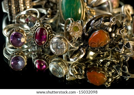 Jeweller ornaments on a black background - stock photo