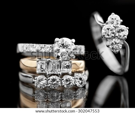Jewellery diamond ring on a black background  - stock photo