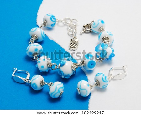 Jewellery set blue and white made of murano glass - stock photo