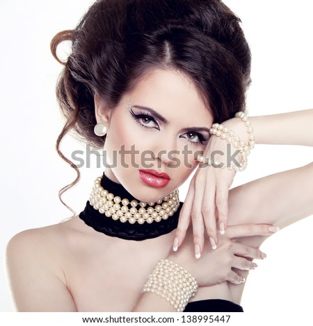 Jewelry and Hairstyle. Fashion portrait of beautiful woman with pearls isolated on white background. - stock photo