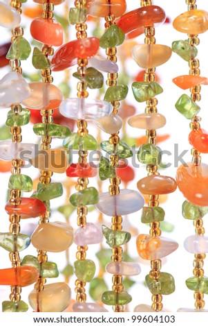Jewelry. Beautiful colorful beads isolated on white background - shallow dof - stock photo