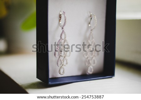 Jewelry box with luxury wedding earrings. Wedding accessories. - stock photo